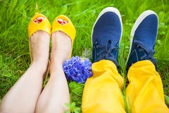 Two pair of legs on grass Royalty Free Stock Images