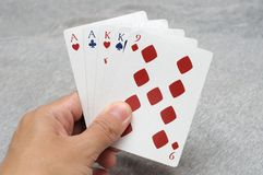 Two Pair poker hands. A photo taken on a hand holding five cards in a poker game showing the poker hands of Two Pair royalty free stock photo