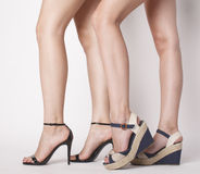 Two pair of woman legs in hight heels shoes Royalty Free Stock Photos