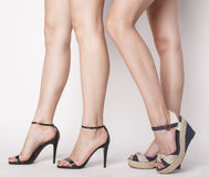 Two pair of woman legs in hight heels shoes Stock Photo