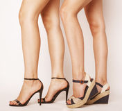 Two pair of woman legs in hight heels shoes Royalty Free Stock Photo