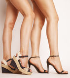 Two pair of woman legs in hight heels shoes Royalty Free Stock Image