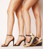 Two pair of woman legs in hight heels shoes Royalty Free Stock Photography