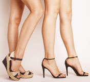 Two pair of woman legs in hight heels shoes Royalty Free Stock Images