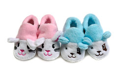 Two pairs of baby blue and pink booties. Stock Photos