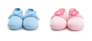 Two pairs of baby boy and girl shoes Royalty Free Stock Photo