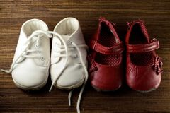Two pairs of baby shoes Stock Images