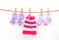 Two pairs baby socks and a cap. Hanging with clipping path Royalty Free Stock Photo