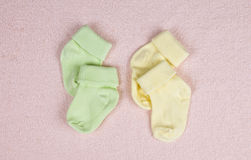 Two pairs of baby socks Royalty Free Stock Photos