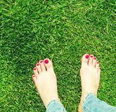 Two pairs of bare feet Royalty Free Stock Image