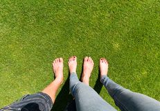 Two pairs of bare feet Stock Photography