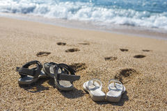 Two pairs of beach shoes Royalty Free Stock Photos