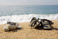 Two pairs of beach shoes Stock Images