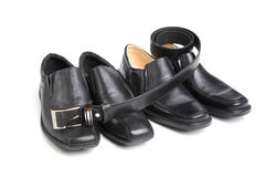 Two pairs black man's shoe and a belt Stock Image