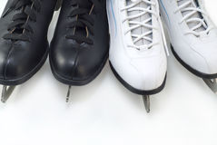 Two pairs of black and white figure skates close-u. Two pairs of black and white figure skates on white background Royalty Free Stock Photography