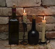 Two pairs of bottles and candles Royalty Free Stock Image