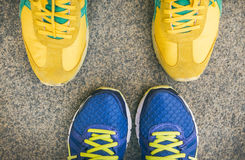 Two pairs of bright sport shoes standing in front of each other Royalty Free Stock Images