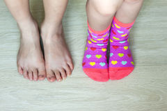 Two pairs of children legs closeup with socks Royalty Free Stock Images
