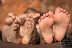Two pairs of  children's feet Royalty Free Stock Photography