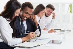 Two pairs of colleagues working. Two pairs of colleagues are working together in white office. Concept of collaboration Stock Photos