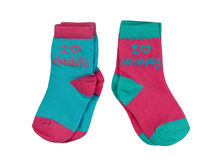 Two pairs of colored children`s socks with the inscription Stock Photo