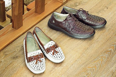 Two pairs of comfortable shoes : for men and for women. Royalty Free Stock Photo