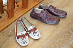 Two pairs of comfortable shoes : for men and for women. Stock Photo