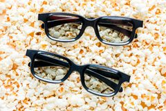 Two pairs of 3d glasses close-up lie. On salted popcorn Royalty Free Stock Photos