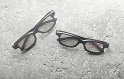 Two pairs of 3d glasses on a gray concrete background. Top view, royalty free stock photo