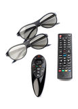 Two pairs of 3D glasses and remote control TV Royalty Free Stock Photo