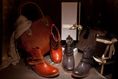 Two pairs of elegant female boots with a leather bag Royalty Free Stock Image