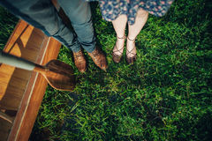 Two pairs of feet on green grass Royalty Free Stock Photo