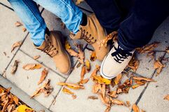 Two Pairs of Feet in Shoes Stock Photos