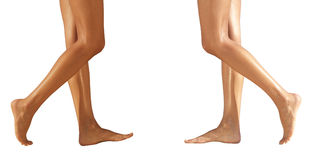 Two pairs female legs on a floor Stock Photo