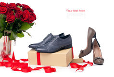 Two pairs of female and male shoes  and bunch of r Royalty Free Stock Photo