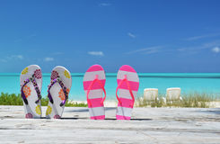 Two pairs of flip-flops Royalty Free Stock Photos