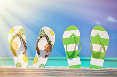 Two pairs of flip-flops. Against Atlantic. Exuma, Bahamas Stock Photo