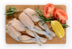 Two Pairs of Fresh Frog Legs on white background Stock Image