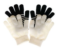 Two pairs of gloves are white and black Royalty Free Stock Photos