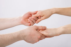 Two pairs of hands holding each other Royalty Free Stock Image