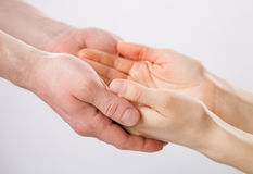 Two pairs of hands holding each other Royalty Free Stock Photography
