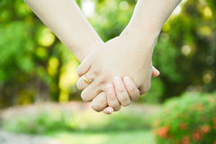 Two pairs of hands in love tenderly hold together Royalty Free Stock Photo