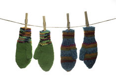 Two Pairs of Hanging Mittens Royalty Free Stock Photo