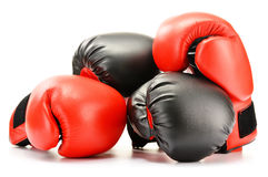 Two pairs of leather boxing gloves on white Stock Images