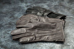Two pairs of leather gloves Stock Photos