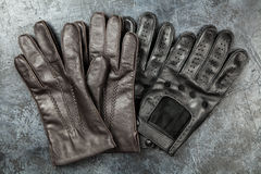 Two pairs of leather gloves Royalty Free Stock Images