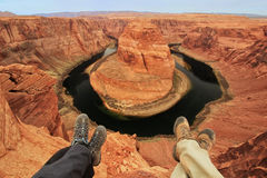 Two pairs of legs at Horseshoe bend overlook Stock Photo