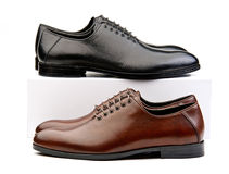 Two pairs of male classic shoes brown and black on Stock Image