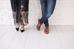 7dc4f2157 Two pairs of male and female legs in shoes are crossed. Couple standing in  front