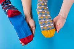 Free Two Pairs Of Female Hands Hold Colored Socks, Stretch Them And Demonstrate, Concept Royalty Free Stock Photos - 166521548
